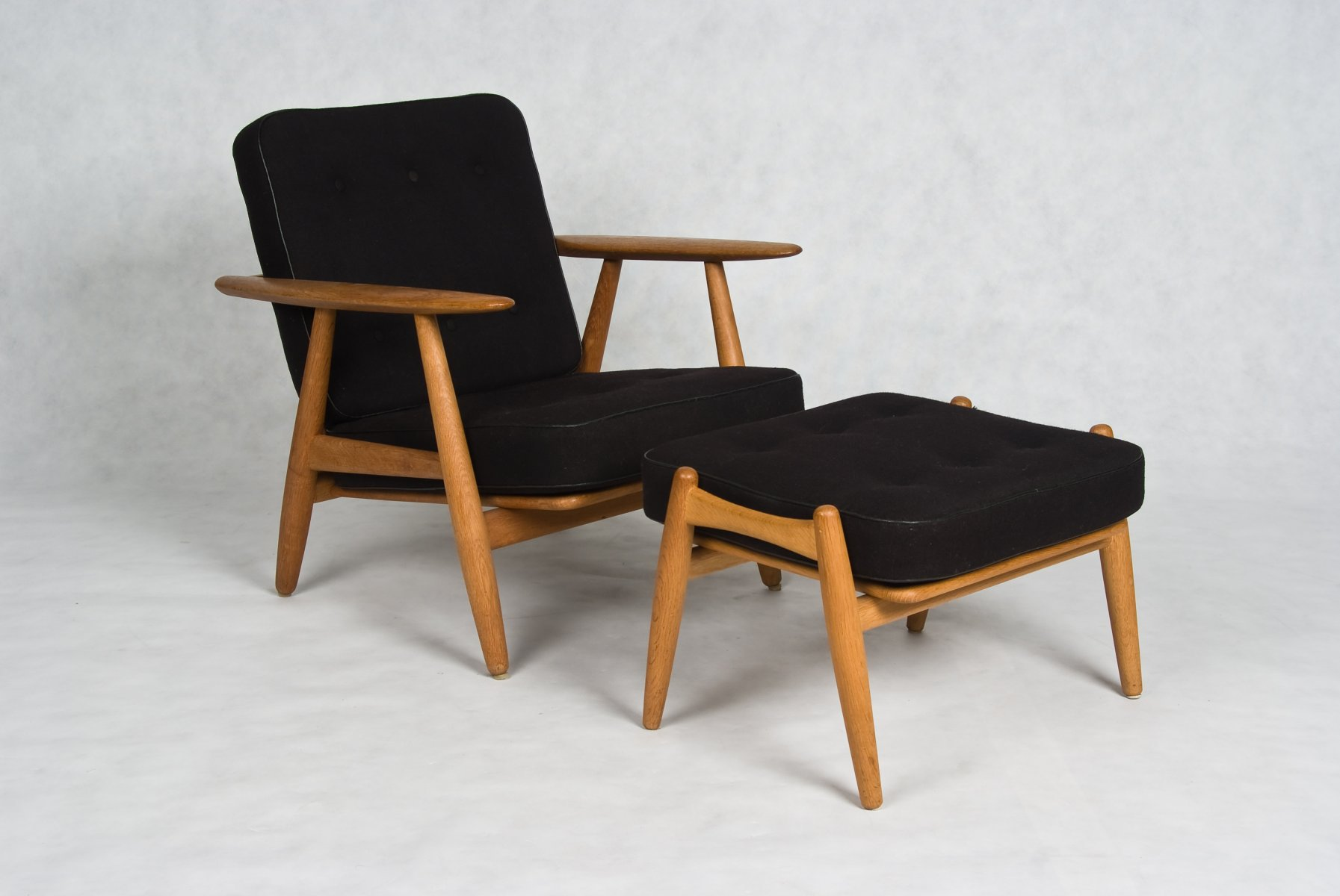 Hans Wegner Cigar Oak chair with stool Model GE 240 designed 1955