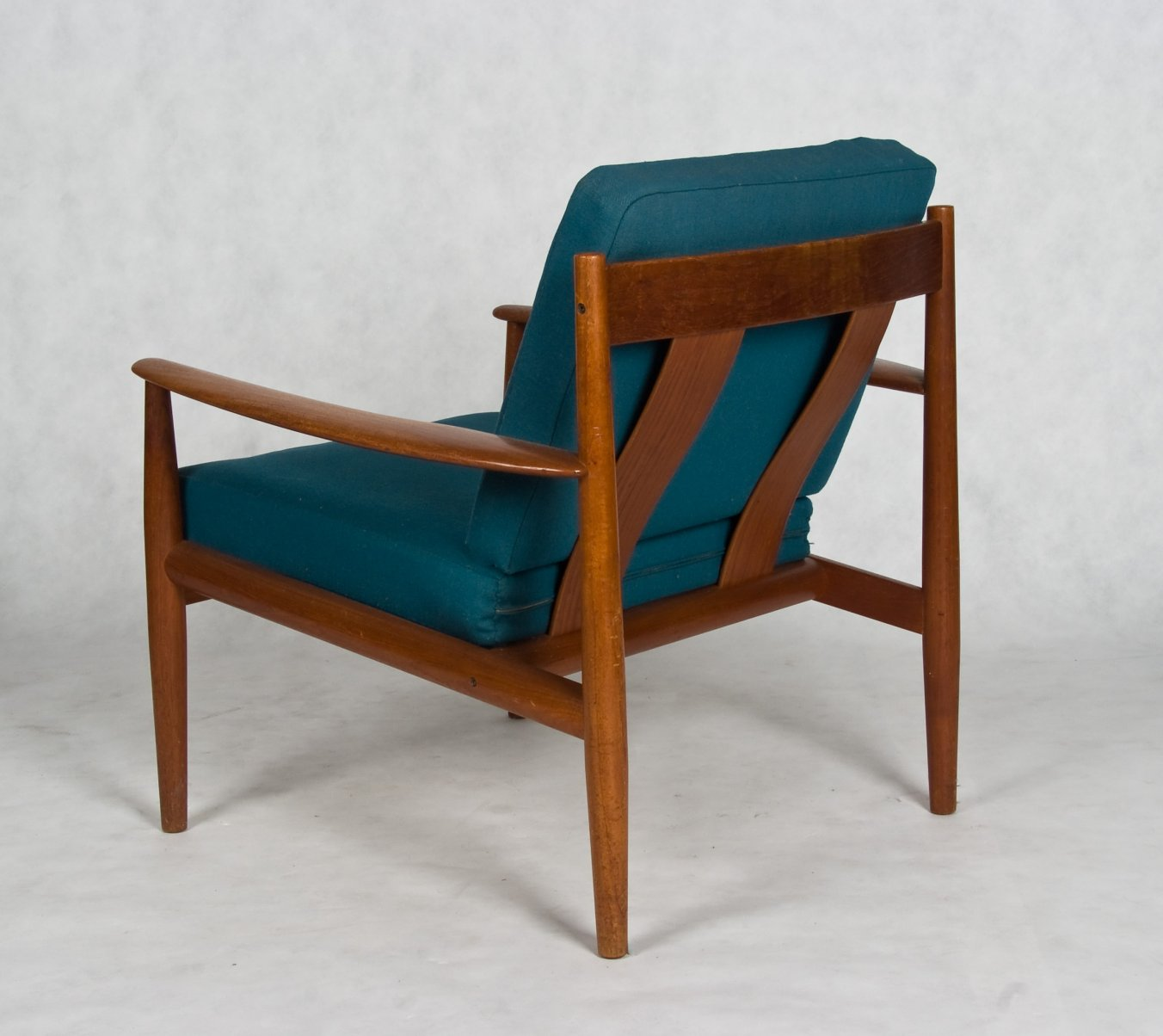 Danish arm chair with teak frame - designed by Grete Jalk